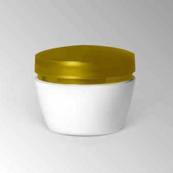 Pot de crème avec bouchon en or.