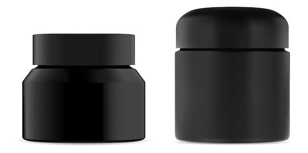 Pot de crème cosmétique en plastique noir.