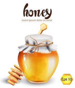 Pot en verre avec du miel et des décorations