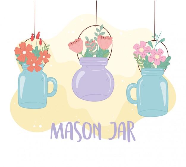 Pots mason suspendus avec des fleurs