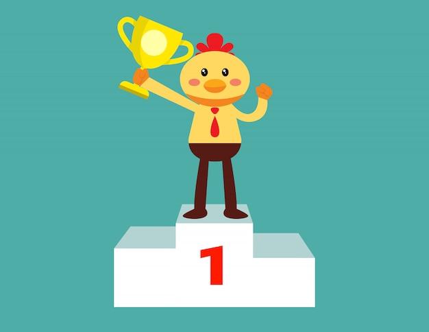 Poulet leader tenant un trophée sur le podium