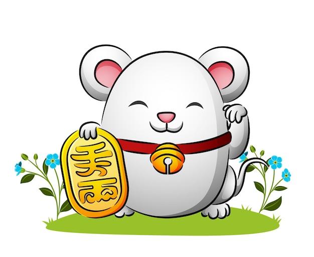 La poupée de la souris porte-bonheur tient la barre d'or de l'illustration