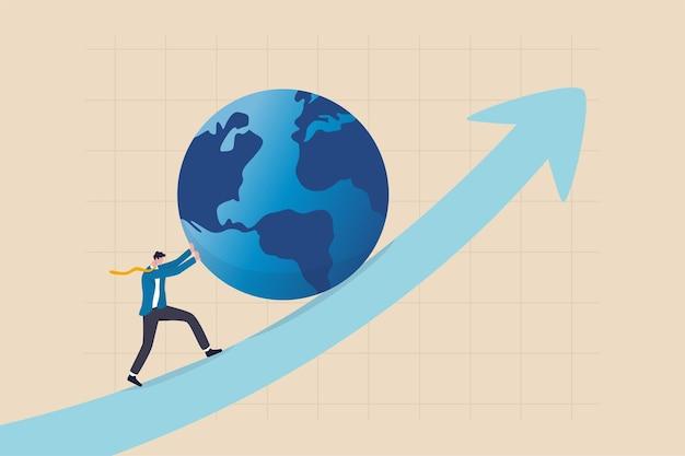 Pousser l'économie mondiale vers l'avant, la croissance des investissements internationaux ou le succès de l'entreprise dans le concept de concurrence commerciale mondiale, le chef d'homme d'affaires pousse le monde vers le haut du graphique avec tous les efforts.