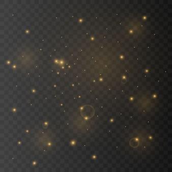 La poussière est jaune. des étincelles jaunes et des étoiles dorées brillent d'une lumière spéciale. le vecteur brille sur un fond transparent
