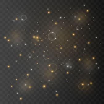 La poussière est jaune. des étincelles jaunes et des étoiles dorées brillent d'une lumière spéciale. le vecteur brille sur un transparent