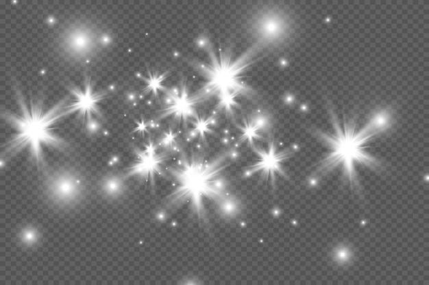 La poussière est jaune. des étincelles jaunes et des étoiles dorées brillent d'une lumière spéciale. le vecteur scintille sur un fond transparent. effet de lumière de noël. particules de poussière magiques étincelantes.