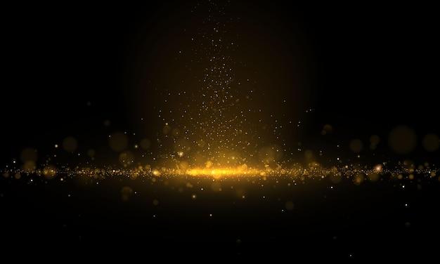 Poussière magique étincelante et particules dorées sur fond noir. glitter et élégant. concept magique. effet bokeh abstrait.