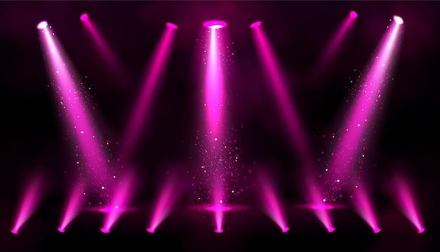 Poutres de projecteur roses avec des étincelles