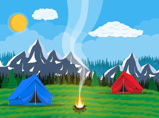 Pré avec herbe et camping.