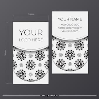 Préparation de cartes de visite de vecteur noir-blanc avec ornement abstrait. modèle de carte de visite de conception d'impression avec des motifs de monogramme.