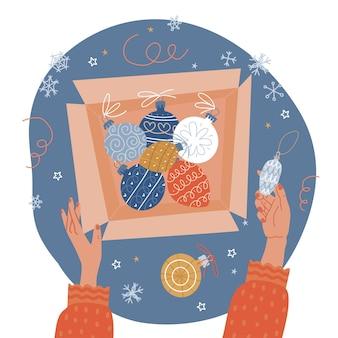 Préparation de noël ouvrant une vieille boîte en carton avec concept de vue de dessus de boules de sapin de noël vintage avec ...
