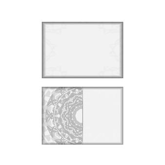 Préparer une invitation avec une place pour votre texte et des motifs grecs. modèle pour les cartes postales de conception d'impression couleurs blanches avec ornement de mandala noir.