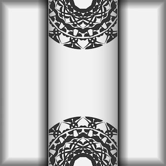 Préparer une invitation avec une place pour votre texte et des motifs grecs. modèle vectoriel pour cartes postales de conception d'impression couleurs blanches avec des motifs de mandala noirs.