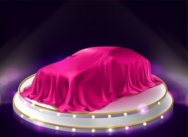 Présentation de la voiture, auto recouvert de voile sur scène
