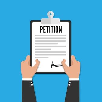 Presse-papiers de pétition à la main