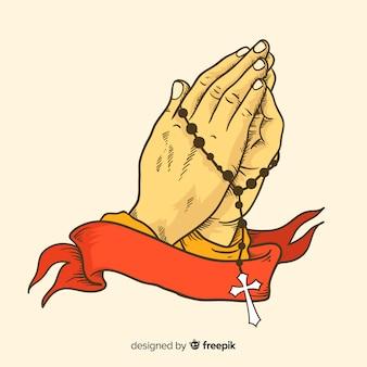 Prier les mains avec un fond de ruban