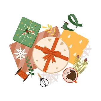 Processus d'emballage des cadeaux de noël vue de dessus préparation des célébrations de noël et du nouvel an