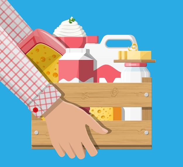 Produits laitiers mis en illustration de boîte en bois
