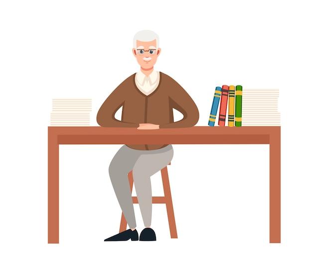 Professeur enseignant principal est assis près de la table