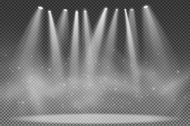 Projecteurs isolés sur fond transparent. projecteur pour le podium. effet lumineux pour une discothèque.