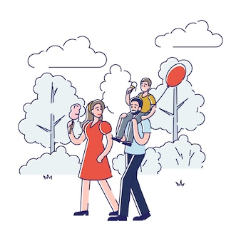Promenade en famille dans le parc. jeunes parents heureux avec fils marchant à l'extérieur