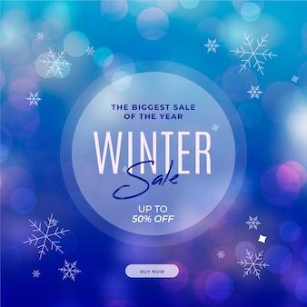 Promo de soldes d'hiver avec des flocons de neige flous