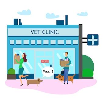 Propriétaire de chien avec des produits pour animaux de compagnie à l'extérieur de la clinique vétérinaire