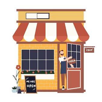 Propriétaire de petite entreprise détenant nous sommes signe ouvert