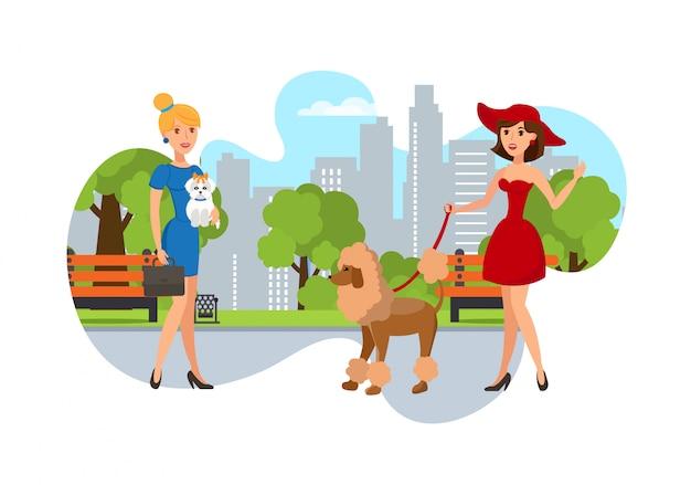 Propriétaires d'animaux élégants promener leurs chiens dans le parc