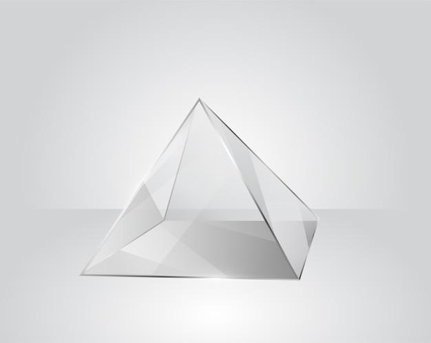 Pyramide en verre clair sur un fond gris moderne