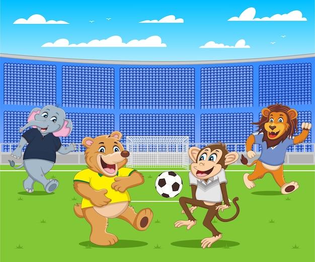 Quatre animaux dessin animé jouent au football sur le stade de football