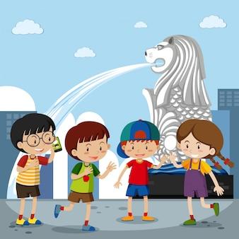 Quatre enfants au merlion à singapour