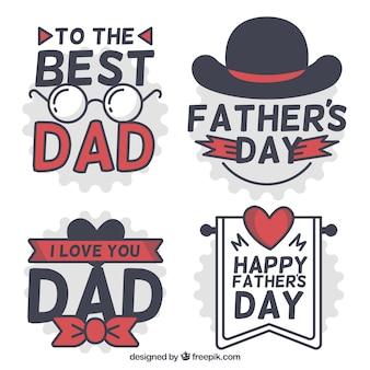 Quatre étiquettes décoratives avec des éléments rouges pour le jour du père