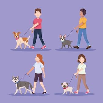 Quatre personnes avec des chiens
