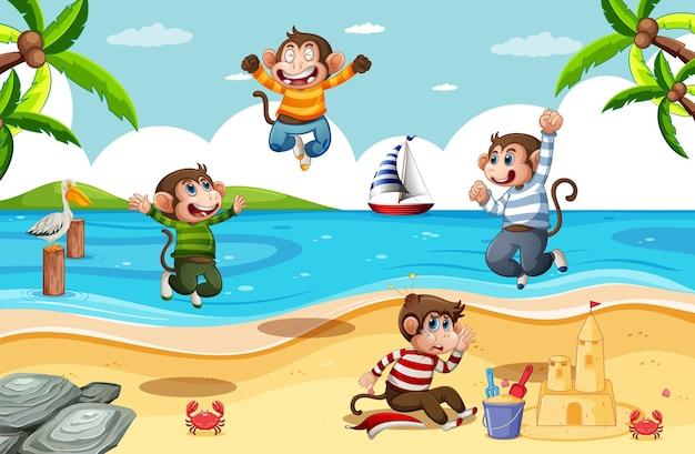 Quatre petits singes sautant dans la scène de la plage