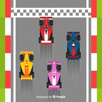 Quatre voitures de course f1 franchissant la ligne d'arrivée