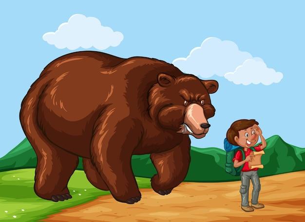 Randonneur et gros ours dans le domaine