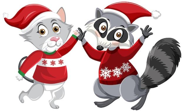Raton laveur mignon et chat portant le personnage de dessin animé de chapeau de noël