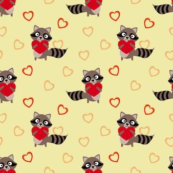 Raton laveur mignon tenir un modèle sans couture coeur rouge.