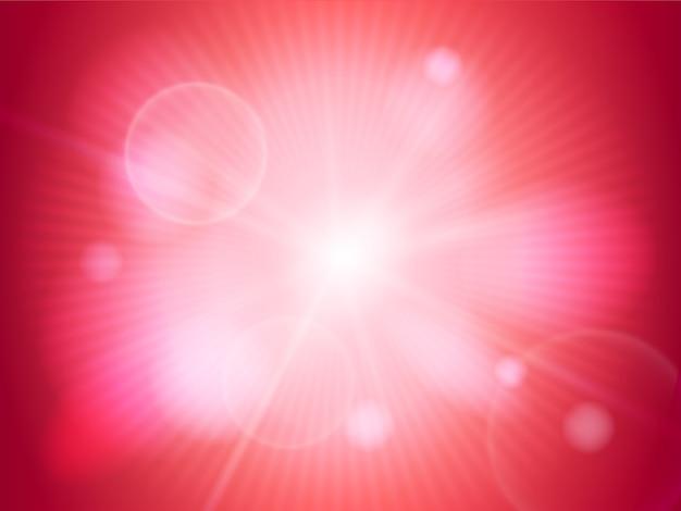Rayon de soleil brillant ou lumière sur fond rouge
