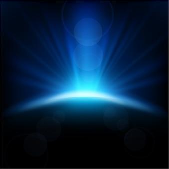 Rayons bleus se levant sur fond sombre