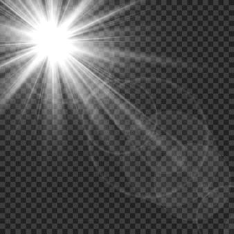 Les rayons du soleil éclairent les reflets des lentilles.