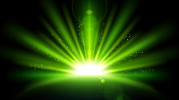 Rayons verts avec lens flare isolé sur fond noir