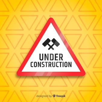 Réaliste sous fond de signe de construction