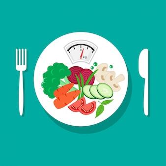 Régime équilibré. alimentation saine. légumes frais sur assiette blanche, fourchette et couteau.