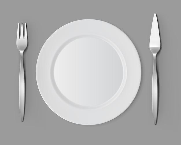 Réglage de la table de couteau fourchette à poisson plaque ronde vide blanc