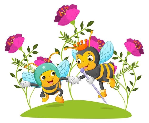 La reine des abeilles avec la couronne aide et tient ses mains de soldat de l'illustration