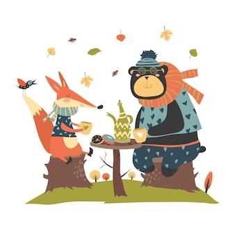 Renard mignon avec ours boire du thé dans la forêt d'automne
