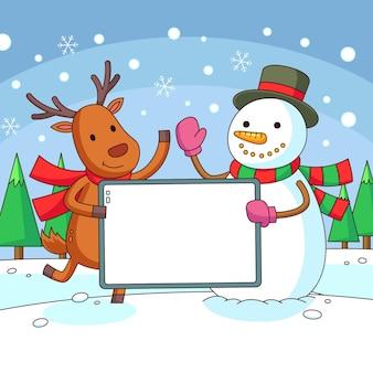 Renne et bonhomme de neige tenant une bannière vierge