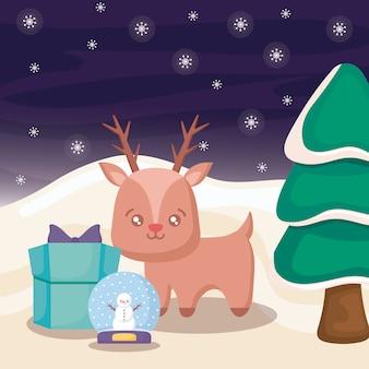 Renne mignon avec boîte-cadeau sur paysage d'hiver